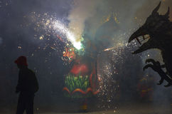 Dragons and devils armed with fireworks dance. Royalty Free Stock Photos