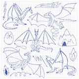 Dragons doodle set. Dragons doodle hand drawn set. Children sketch fantasy animals on squared background Royalty Free Stock Photography