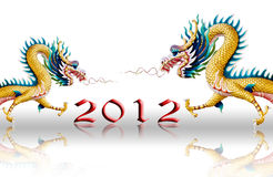 Dragons fly with 2012 on glaze background Stock Image