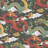 Dragons on green. Green and red dragons fighting in the clouds. Seamless pattern for textile and decoration Stock Photos