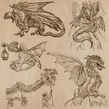 Dragons. An hand drawn vectors in one pack. DRAGONS. Collection of an hand drawn illustrations (line art vectors - pack no.1). Each drawing comprises of three Stock Photo
