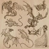 Dragons. An hand drawn vectors in one pack. DRAGONS. Collection of an hand drawn illustrations (line art vectors - pack no.2). Each drawing comprises of three Stock Photo