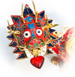 Dragons love. Dragon's love. Close-up of Chinese enameled dragon head with heart in mouth Stock Image