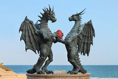 Dragons in Love sculpture in Varna, Bulgaria. Dragons in Love sculpture in the Sea Garden at the coast of Black Sea in Varna, Bulgaria. The sculpture by artist royalty free stock photo