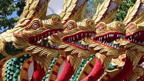 Dragons near entrance to Big Golden Buddha statue in Pattaya, Thailand stock video