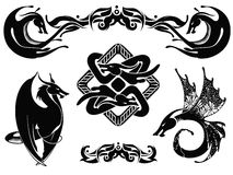 Dragons and ornaments set 1. Dragons and ornaments silhouettes, isolated in set Royalty Free Stock Photo