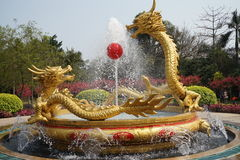 Dragons with red ball fountain Royalty Free Stock Photography