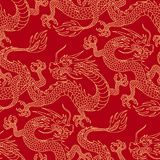 Dragons on red. Chinese dragons fighting, gold outlines on red. Seamless pattern for textile and decoration Stock Photography