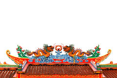 Dragons on roof top. On top of Chinese  temple roof on white background Royalty Free Stock Photography