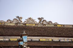 Dragons on rooftop of Citadel of Hue Vietnam. Ornate tile dragoons on rooftop in Citadel of Hue, Vietnam stock image