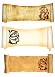 Dragons. Scrolls of old parchments. Dragons. Collection of scrolls old parchments. Objects isolated over white Royalty Free Stock Image