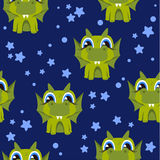 Dragons set on a white background. Cartoon dragons on a dark blue background and stars, seamless background for a children theme Stock Photo