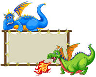 Dragons and sign Stock Image