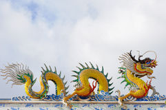 Dragons statue on the roof of Chinese temple Royalty Free Stock Photos