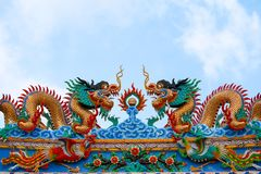 Dragons and swans in Chinese art adorn arches of entrance to the stock photo