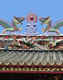 Dragons on a temple roof. Dragon on a roof of a Vietnamese temple stock photos