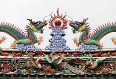 Dragons on a temple roof. Dragon on a roof of a Vietnamese temple royalty free stock image