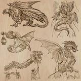 dragons Vecteurs tirés par la main dans un paquet Photo stock