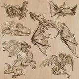 dragons Vetores tirados uma mão em um bloco Imagens de Stock