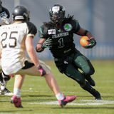 Dragons vs. Rangers. VIENNA,  AUSTRIA - APRIL 14 RB Tunde Ogun (#1 Dragons) runs with the ball during the AFL football game on April 14, 2013 in Vienna, Austria Royalty Free Stock Photography