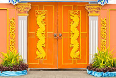 Dragons on wooden doors. Stock Image