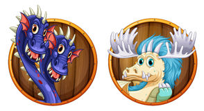 Dragons on wooden round badges Royalty Free Stock Photography