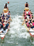 Dragontug Challenge. A novelty tug of war challenge between two dragonboat teams attached by a rope over a pulley system, an event held on the Singapore River Stock Images