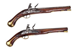 Dragoon pistols. A pair of antique military dragoon pistols set on a white background - circa 18th cent pattern Royalty Free Stock Photography