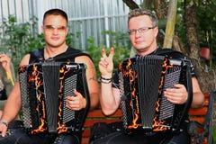 Dragspels- duett royaltyfri fotografi