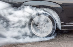 Dragster Car Burn Out Rear Tyre With Smoke. At start line stock image