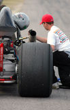 Dragster receiving service. Mechanical service on a dragster prior to the race Royalty Free Stock Photo