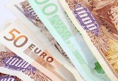 Drahmas en Euro Stock Afbeeldingen