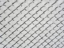 Draht-Zaun im Schnee Lizenzfreie Stockfotos