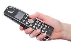 Drahtloses Telefon in der Hand der Frau lizenzfreies stockbild