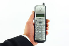 Drahtloses Telefon in der Hand getrennt auf Weiß Lizenzfreie Stockbilder