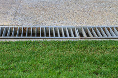 Drain in back garden Royalty Free Stock Image