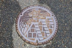 Drain cap art on the surface of sewer cover on the walk way Shirakawa-go Royalty Free Stock Images