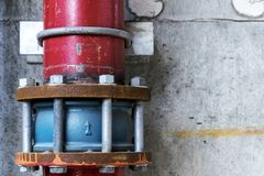 Drain connection Made of steel. Is large industrial projects,The main vent is red,The joints are blue joints,The nail-bolt is attached together,Have been rust royalty free stock images