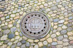 Drain cover with the seal of Freiburg im Breisgau Royalty Free Stock Photography