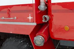 Drain or drain pipe on a red fire truck stock photo