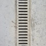 Drain grate in concrete floor Stock Photography