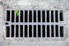 Drain grate in the sandy surface Stock Photos