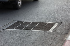 Drain grating on road in Thailand Royalty Free Stock Image