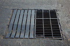 Drain grating on road in Thailand Royalty Free Stock Photo