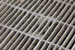 Drain grating on road in Thailand, background Royalty Free Stock Image