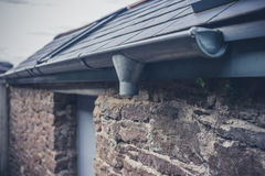 Drain and gutter on roof Stock Photography