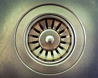 Drain hole metallic. Close up a drain hole metallic kitchen sink Royalty Free Stock Photos