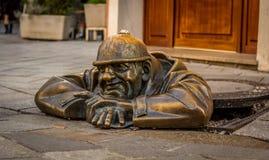 Drain inspector. Famous street  sculpture in Bratislava Stock Photos