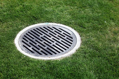 Drain Manhole surrounded by grass Stock Image