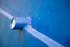 Drain pipe on blue wall at home Royalty Free Stock Photo